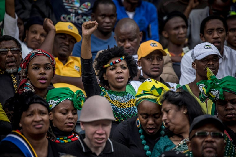 A woman raises her fist during the funeral for Winnie Madikizela-Mandela, held at Orlando Stadium on April 14, 2018, in Soweto, South Africa.