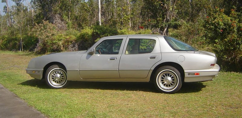 Illustration for article titled Could This 1990 Avanti LTS Four-Door Be Worth $28,000? It's Got Three DVD Players!