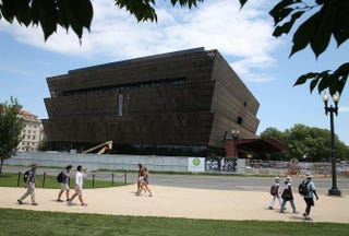 Tourists walk past the Smithsonian Institution's National Museum of African American History and Culture during its construction July 16, 2015, on the National Mall in Washington, D.C.Mark Wilson/Getty Images