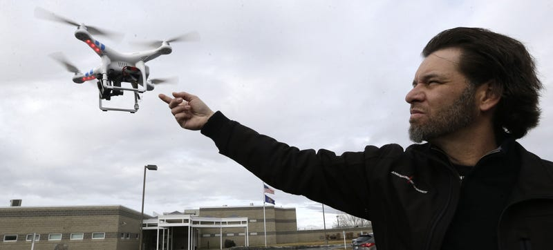 Jon McBride, who designs and builds drones with Digital Defense Surveillance, flies a training drone for members of the the Box Elder County Sheriff's Office search and rescue team, during a demonstration, in Brigham City, Utah. Image Credit: Rick Bowmer/AP Images