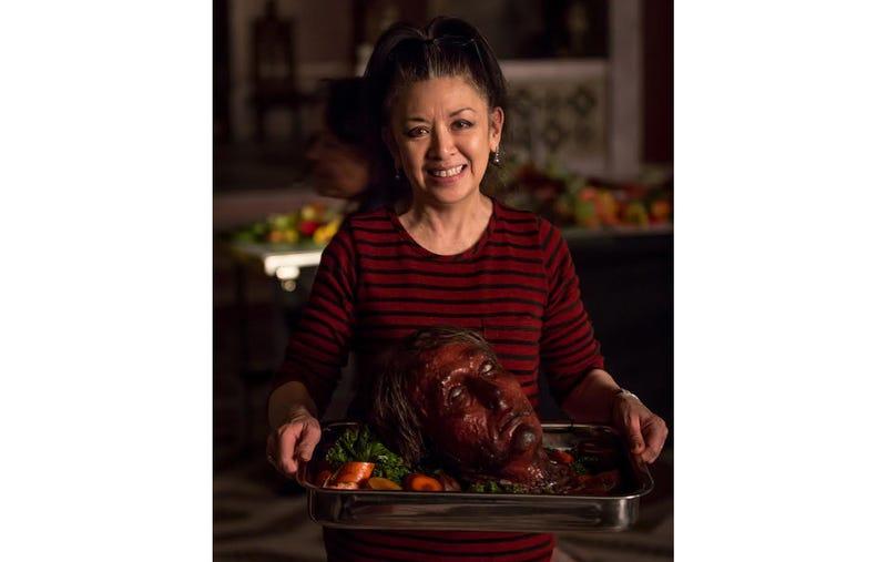 Food stylist Janice Poon holds a Peking Duck Hannibal head. (Photo: Titan Books/Brilynn Ferguson)