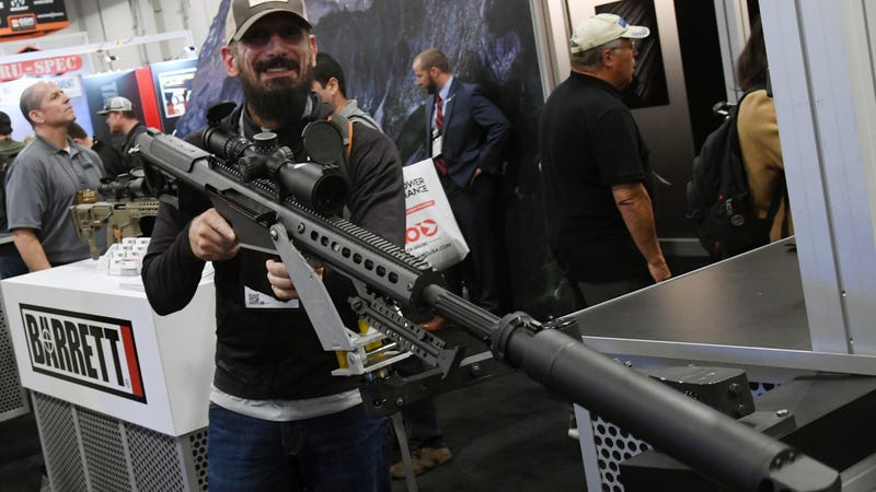 Eros Adragna of Texas looks at a .50-caliber semi-automatic Browning Machine Gun at the Barrett booth at the 2018 National Shooting Sports Foundation's Shooting, Hunting, Outdoor Trade Show at the Sands Expo and Convention Center on Jan. 23, 2018 ,in Las Vegas.