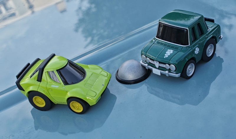Two Japanese toy cars on a... Japanese toy car!