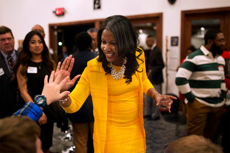 Tishaura Jones high-fives guests at a campaign kickoff party for her St. Louis mayoral run in January. (Carolina Hidalgo/St. Louis Public Radio)