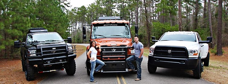 What type of truck is the orange one in the middle?