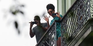 Jay-Z and Beyoncé on the balcony of the Saratoga Hotel in Havana (STR/AFP/Getty Images)