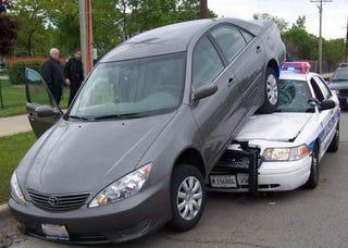 Illustration for article titled Old Man Backs Over Cop Car... Accidentally