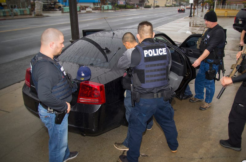 Photo of U.S. Immigration and Customs Enforcement agents performing targeted enforcement operations on February 7 via AP