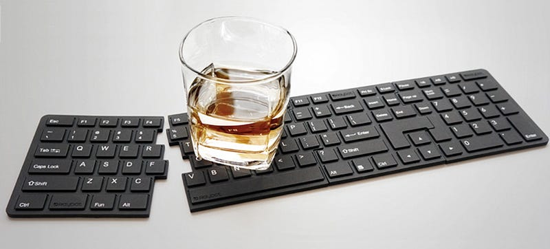 Illustration for article titled Your Heart Won't Skip a Beat When You Spill On Fake Keyboard Coasters