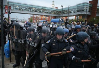 Police in riot gear block a street during a march in honor of Freddie Gray on April 25, 2015, in Baltimore.Alex Wong/Getty Images
