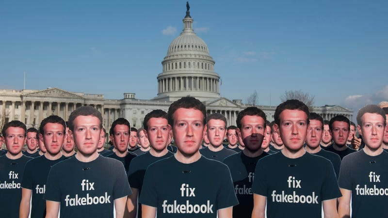 Illustration for article titled Army of Cardboard Mark Zuckerbergs Mock Facebook CEO from Capitol Lawn