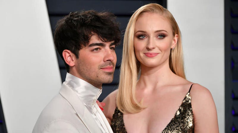 Illustration for article titled Diplo and his dumb cowboy hat are here with footage of Sophie Turner and Joe Jonas' Vegas wedding