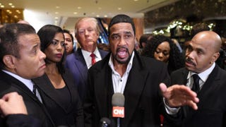 Republican candidate Donald Trump (fourth from left) arrives to speak to the press with the Rev. Darrell Scott (center), senior pastor of the New Spirit Revival Center in Cleveland Heights, Ohio, after meeting with African-American pastors at Trump Tower in New York City Nov. 30, 2015.TIMOTHY A. CLARY/AFP/Getty Images