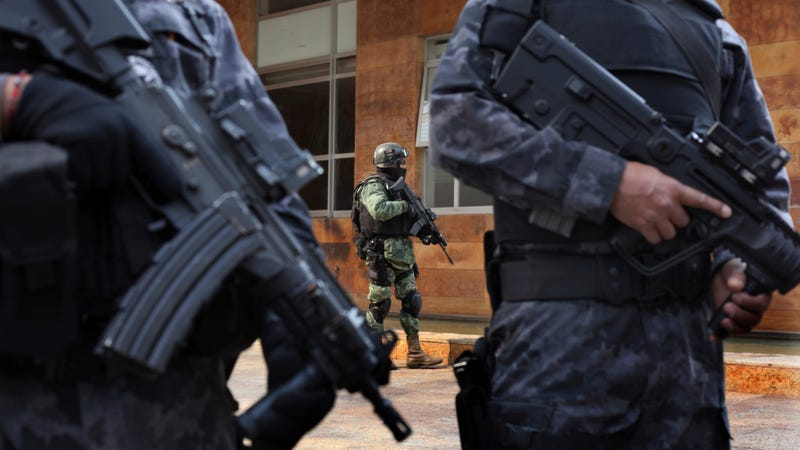 Police stand guard outside a building in Mexico City where authorities arrested an alleged Sinaloa cartel leader in 2017.