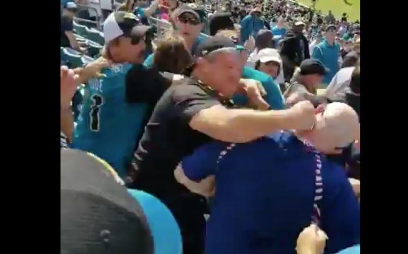 Illustration for article titled Jaguars Fan Knocks Texans Fan Out Cold With Devastating Sucker Punch