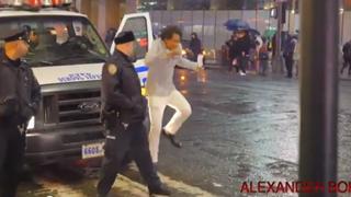Alexander BOK shown here executing Ellen DeGeneres' dance dare behind a New York City police officerYouTube screenshot