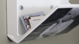 Illustration for article titled Repurpose a VHS Tape Case as a Photo Display and Storage Box