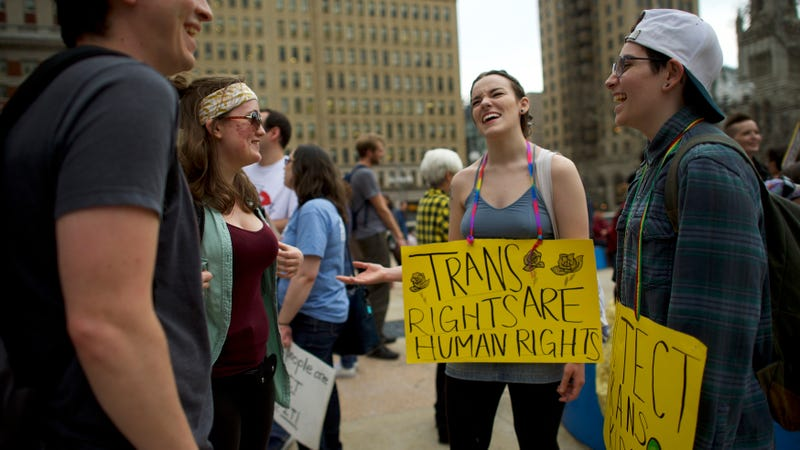 Protestors laugh during a rally against the transgender bathroom rights repeal in Philadelphia, Pennsylvania.