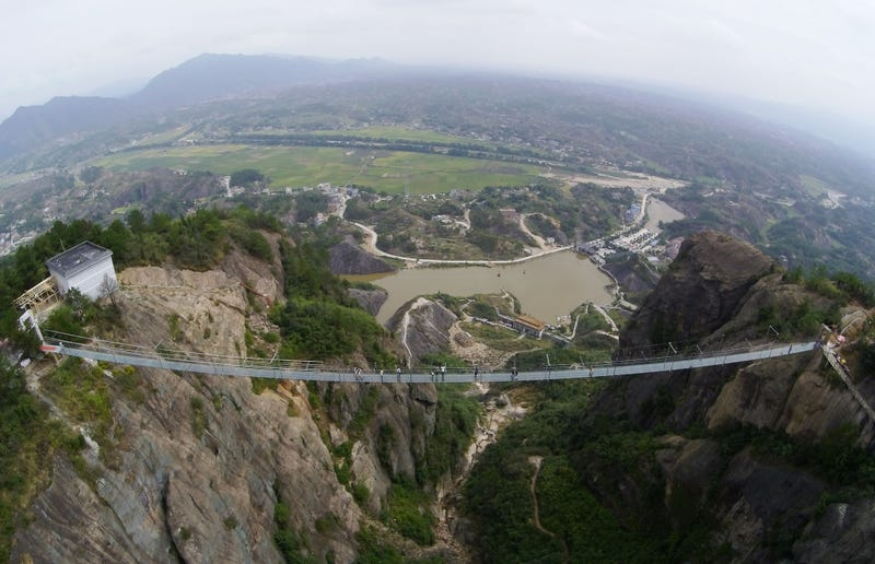 Illustration for article titled The Longest Glass Bridge on Earth Caters to Tourists Who Like Being Scared Silly