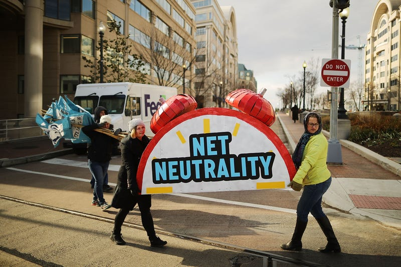 Rally organizers carry away props following a protest outside the Federal Communications Commission building against the end of net neutrality rules Dec. 14, 2017, in Washington, D.C. (Chip Somodevilla/Getty Images)