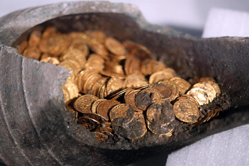 The gold coins found in the soapstone jar.