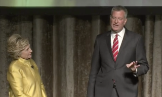 Democratic presidential candidate Hillary Clinton and New York Mayor Bill de Blasio performing the controversial skit during a political roast by the Inner Circle organization April 9, 2016YouTube screenshot