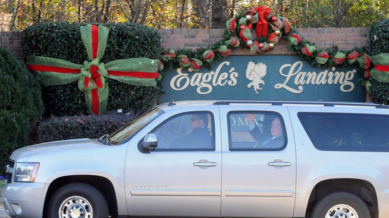 An SUV believed to transporting Republican presidential candidate Herman Cain enters the Eagle's Landing Country Club in McDonough, Ga., Friday, Dec. 2, 2011. Cain lives in the community and was coming home to meet with his wife.