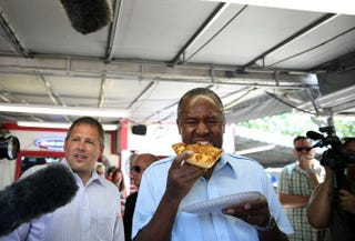 Presidential hopeful Ben Carson, pictured eating a piece of pizza while touring the Iowa State Fair this year, so far as we know, has not been arrested while black while also being Ben Carson.Justin Sullivan/Getty Images