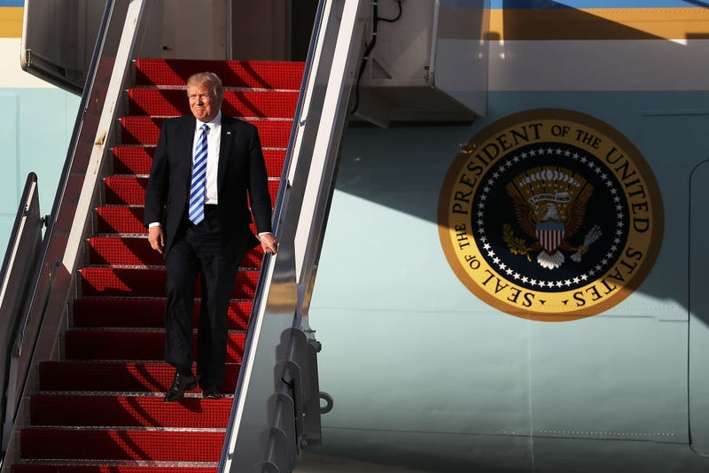 President Donald Trump arrives on Air Force One at the Palm Beach International Airport to spend Easter weekend at Mar-a-Lago in West Palm Beach, Fla.,on April 13, 2017. (Joe Raedle/Getty Images)