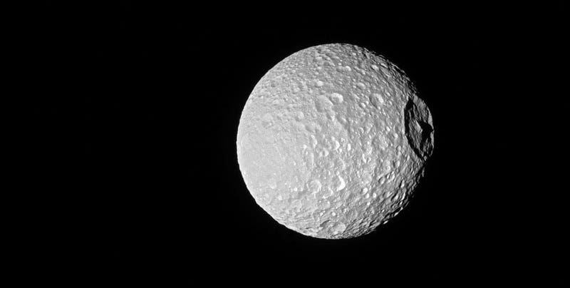 Illustration for article titled Saturn's 'Death Star' Moon Looks Spooky as Hell in New Cassini Photo