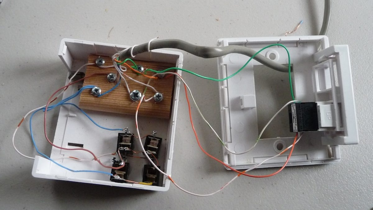 set up a low-tech, whole-house speaker system through existing phone lines
