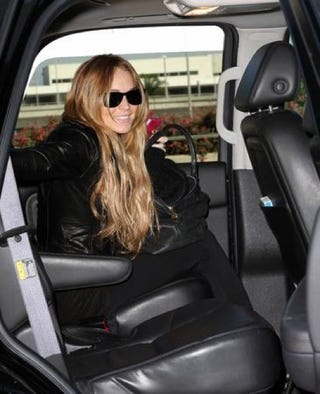 Illustration for article titled Leather-Clad Lindsay Lohan Arrives In Style