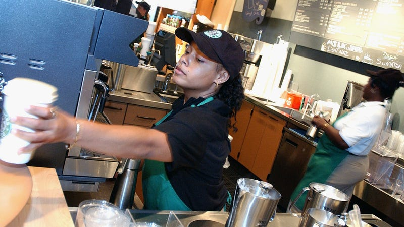 A Starbucks employees readies a beverage for a customer in a New York City store in 2003.