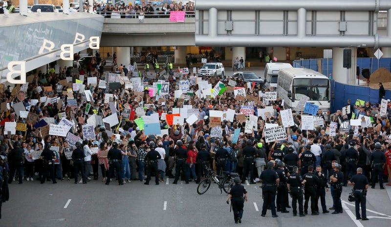 Protestors outside Los Angeles International airport on Sunday (Ryan Kang/Associated Press)