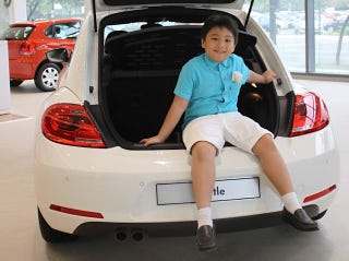 Illustration for article titled See this kid? he won a Beetle.