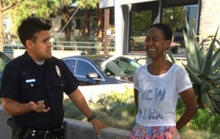 Danièle Watts with a Los Angeles police officer on Sept. 11, 2014, when she says she was unjustly harassedBRIAN JAMES LUCAS via Facebook