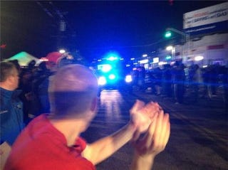Illustration for article titled I am loving photos of people cheering the law enforcement in Watertown