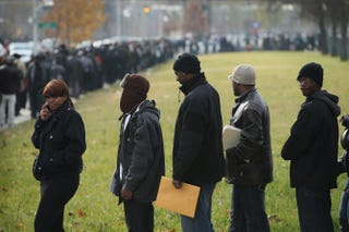 Job seekers wait in line at Kennedy-King College to attend a job fair hosted by the city of Chicago, Nov. 9, 2012.Scott Olson/Getty Images