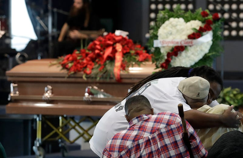 Mourners embrace before the funeral services for police-shooting victim Stephon Clark at Bayside of South Sacramento Church on March 29, 2018, in Sacramento, Calif. Clark, who was unarmed, was shot and killed by Sacramento police officers March 18, 2018.