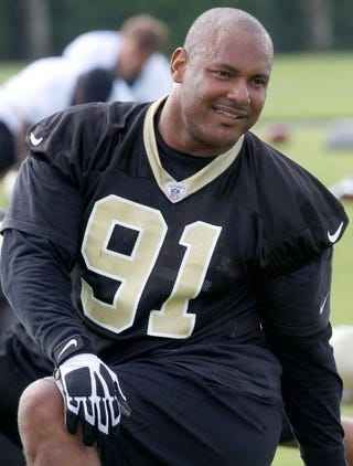 Will Smith, then No. 91 of the New Orleans Saints, stretching at the Saints training facility May 24, 2012, in Metairie, La. Sean Gardner/Getty Images