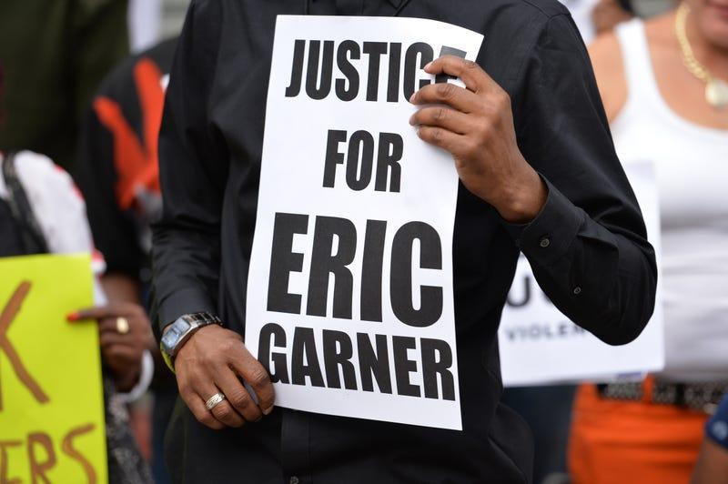 Demonstrators rally against police brutality in memory of Eric Garner on Aug. 23, 2014, on Staten Island, N.Y.STAN HONDA/AFP/Getty Images