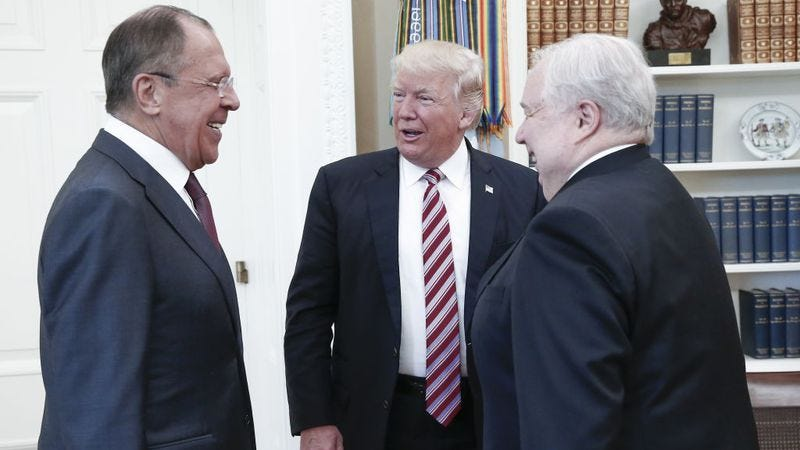 Trump and the Sergeys enjoy a laugh. Photo: Alexander Shcherbak  / Getty