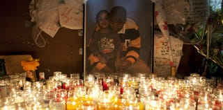 Photo of Kimani Gray and his younger sister is illuminated by candles at memorial, March 13, 2013. (Allison Joyce/Getty Images)