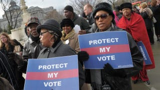 Activists held pro-voting-rights placards outside the Supreme Court on Feb. 27, 2013, in Washington, D.C., as the court prepared to hear Shelby County v. Holder.MANDEL NGAN/AFP/Getty Images