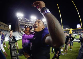 Trevone Boykin of the TCU Horned Frogs walks off the field with his sister, Makayla Mosley, after the Horned Frogs beat the West Virginia Mountaineers 40-10 at Amon G. Carter Stadium on Oct. 29, 2015, in Fort Worth, Texas.Tom Pennington/Getty Images