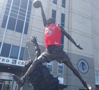 Illustration for article titled Bulls Fans Break Out The Big Guns, Clothe Michael Jordan Statue