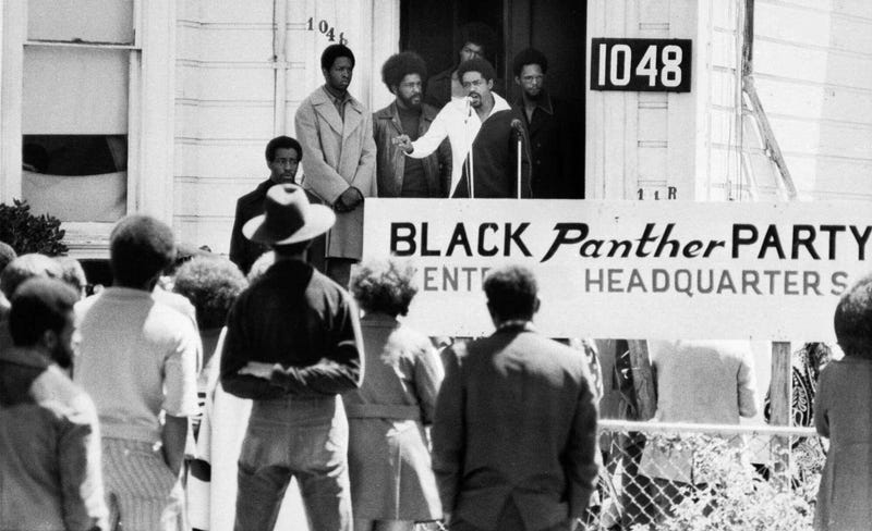 Bobby Seale, chairman of the Black Panther Party, addresses a rally outside the party headquarters in Oakland, Calif., urging members to boycott certain liquor stores. (File/AP Images)