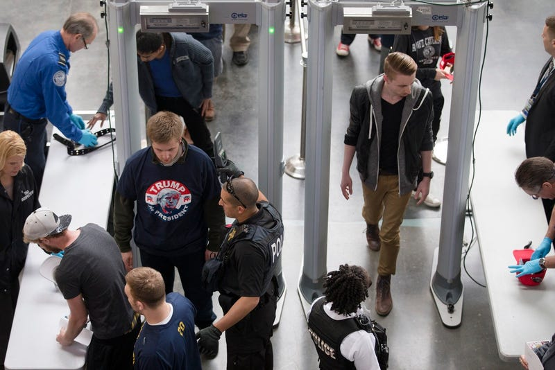 Attendees make their way through a security checkpoint at a Trump rally in Buffalo, New York on April 18, 2016 (AP Photo/John Minchillo)
