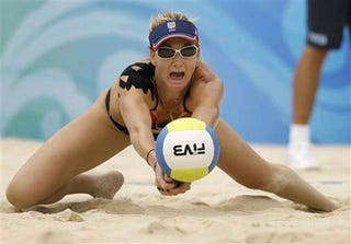 Illustration for article titled Tattoo? Symbiote? What the Hell is That Thing On Olympian Kerri Walsh's Shoulder?