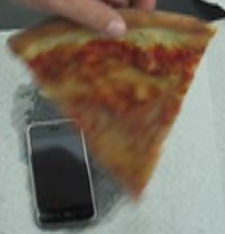 Illustration for article titled More iPhone Destruction, Now With Pizza